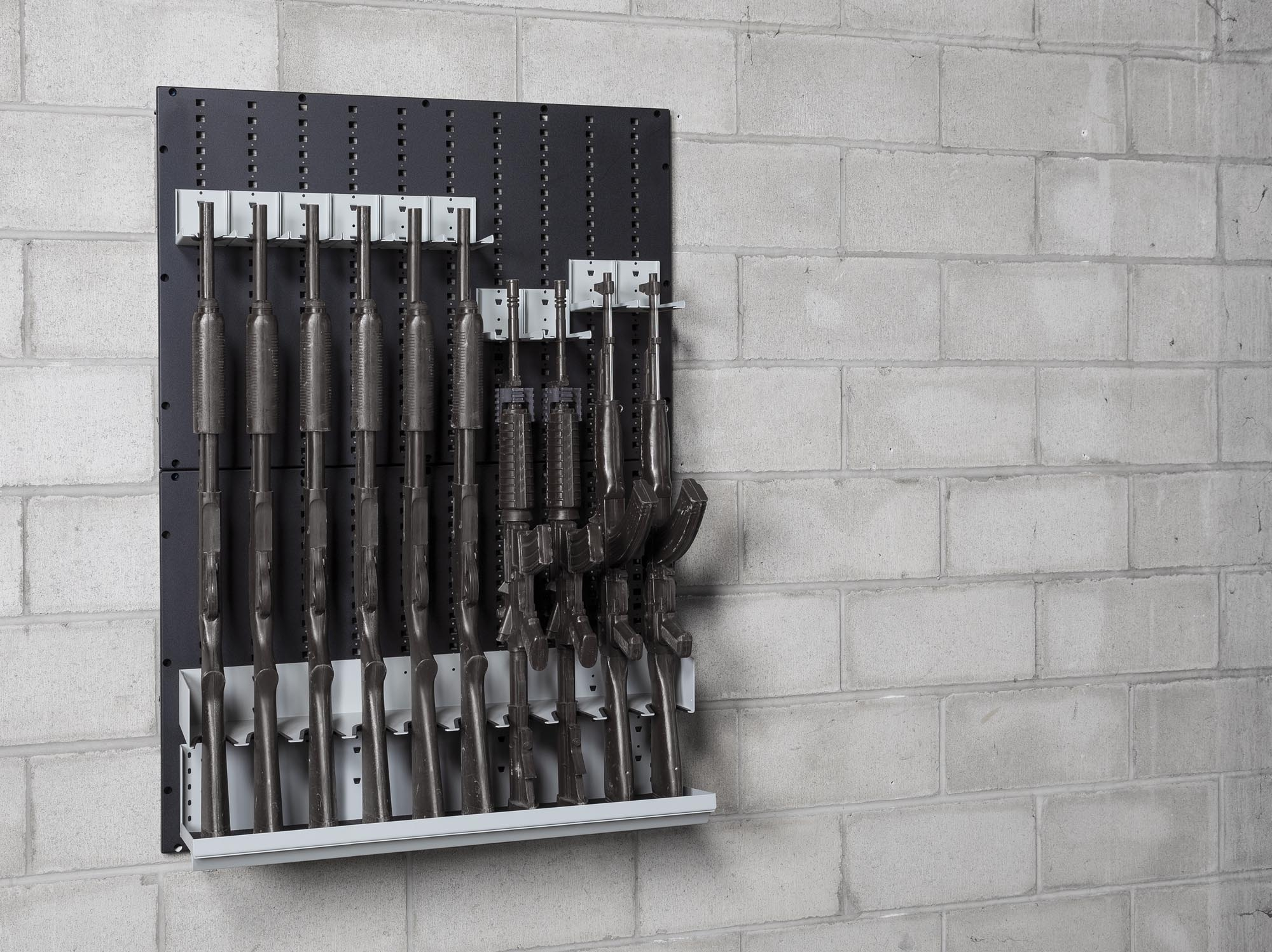 Weapon wall mount panels with weapons